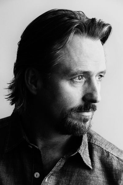 """Linus Roache is a series regular on Showtime's hit """"Homeland."""" He is currently shooting the final season of in Morocco. """"Priest,"""" """"Wings of a Dove,"""" """"Chronicles of Riddick,"""" """"Batman Begins,"""" and Panos Cosmatos' visionary movie """"Mandy"""" (Sundance) are just a few of Linus Roache's film credits. He won a London Evening Standard Award for his portrayal of Samuel Taylor Coleridge in Julien Temple's """"Pandaemonium"""" and was nominated for aGolden Globe for his portrayal of Robert Kennedy in the FX TV Movie """"RFK."""" His recent Television credits include three seasons on NBC's """"Law and Order,"""" and """"History's Vikings."""" Later this year he can be seen in Todd Robinson's feature, """"The Last Full Measure."""" He lives in New York with his Wife, Ros and two cats Chloe and Cooper."""