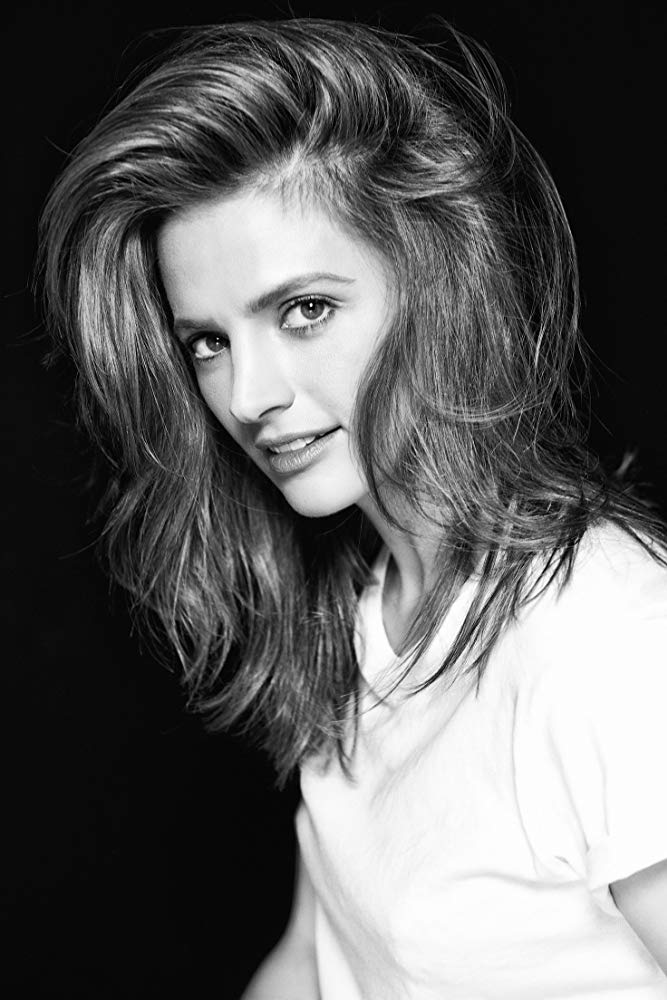 """Stana Katic currently plays the lead role of Emily Byrne in """"Absentia,"""" streaming on Amazon. It's a thriller-drama produced by Sony Pictures Television. Upon debut it was one of Amazon's top-ten most popular programs. Stana's feature film work includes: """"The Possession of Hannah Grace,"""" """"CBGB,"""" """"Big Sur,"""" """"The Spirit,"""" """"Feast of Love,"""" """"The Double"""" and Bond franchise installment """"Quantum of Solace."""" For 8 seasons, Stana stared as Kate Beckett on """"Castle."""" The ABC hit series brought in over 10 million viewers weekly and is in the top five syndicated series in Spain, France, the UK, Italy, and Germany. Stana has ten award nominations and seven wins — including three People's Choice Awards, a PRISM Award, and three TV Guide Awards. Stana is also dedicated to philanthropic projects with a focus on the Environment and on Children's Education and Healthcare. This work has kept her involved with organizations from around the globe. Stana currently resides in Los Angeles."""